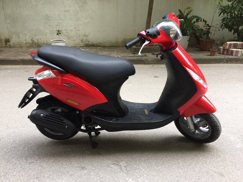 Minh co chiec xe muon ban Piaggio Zip100 nhap doi 2011 mau vang cam dang ky tai ha noi bien 30M8296
