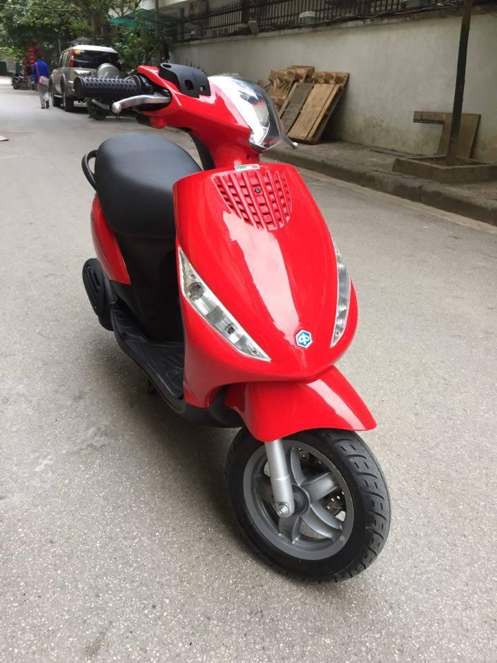Minh co chiec xe muon ban Piaggio Zip100 nhap doi 2011 mau vang cam dang ky tai ha noi bien 30M8296 - 2