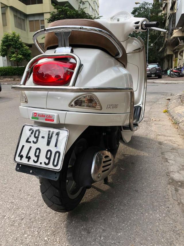 Ban Vespa LX150 doi 2013 nhap khau Italia 29V 44990 so nguyen ban 235tr mau trang do nu su dung xe